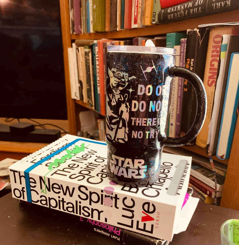 Decorative image of coffee mug and books.